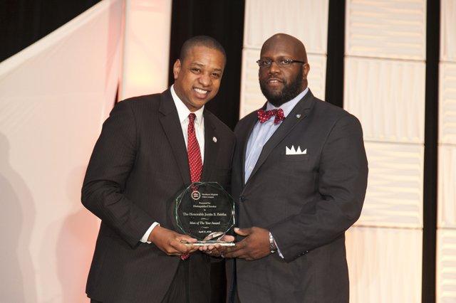 Lt. Gov. Fairfax accepts award.