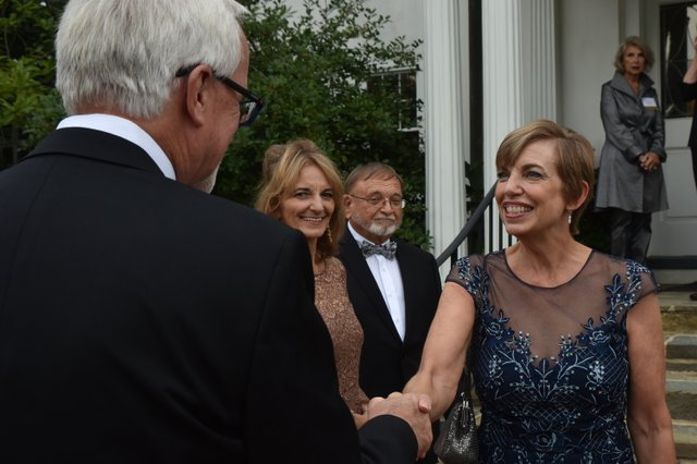 Beth Tuttle greets Jakob Evans and Mickey and Vernon Olin..JPG