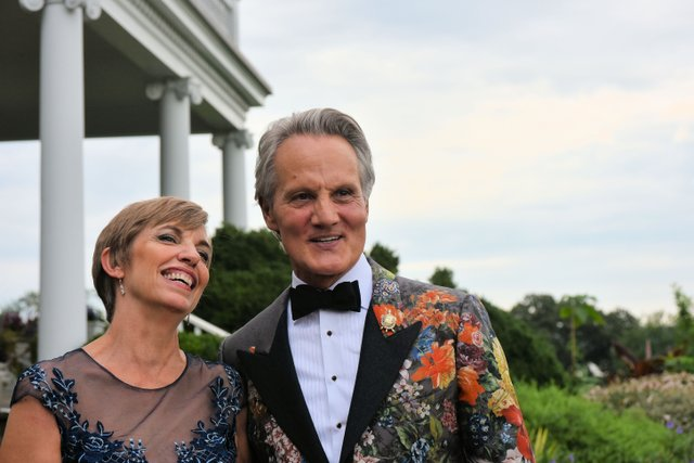 President & CEO of AHS Beth Tuttle and honorary chair Monte Durham greet guests outside the mansion at River Farm..jpg