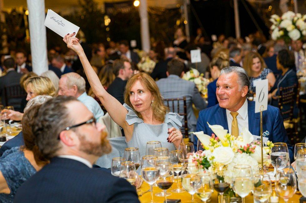Angela Moore bids on an item at the Spirit of Mount Vernon gala.