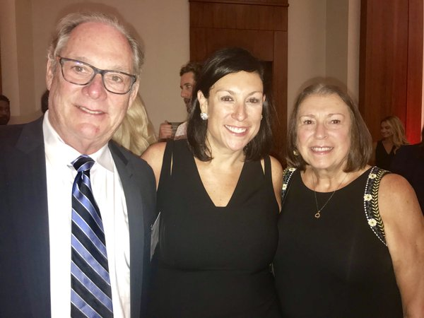 AEDP's Stephanie Landrum flanked by her parents Wednesday night at Chamber awards.