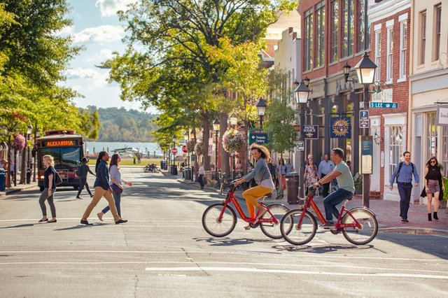 King-Street-couple-biking-epic-CREDIT-Kristian-Summerer-for-Visit-Alexandria-720x480-c3c09fa5-456f-4453-966c-da33398ffce5.jpg