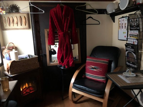 Shed 1 chair and fireplace.JPG
